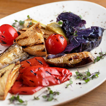 Tasty grilled vegetables on the table, serving in a restaurant, menu food concept.