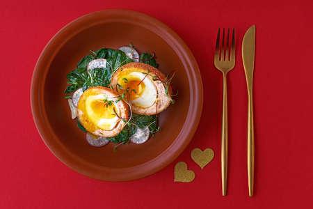 Typical British dish Scotch egg. red background.