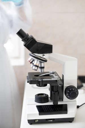 scientists examining liquid samples in the lab.
