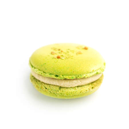 green round baked almond flour macaron isolated on a white background