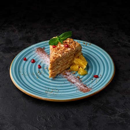 piece of Napoleon cake. Layered cake with custard Stock Photo
