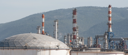Gas pipes and storage tanks on an oil refinery plant