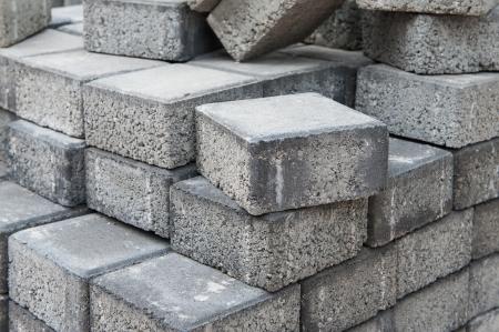 disordered: Disordered stockpile of gray square pavement bricks Stock Photo