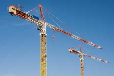 2 tower cranes on a blue sky background. photo