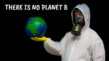 There is no planet B - a man in a gas mask and a chemical protection suit protests. A person speaks about the danger of toxic pollution of the environment. Eco protest for saving planet Earth