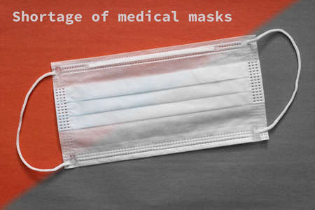 Shortage of Medical Masks concept. An outbreak of coronavirus has led to a shortage of surgical face masks, protective suits and safety glasses. Coronavirus COVID-19 sold out medical mask deficiency
