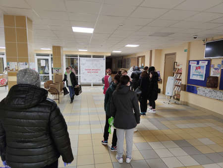 April 6, 2019, St. Petersburg, Russia: Dispensing humanitarian aid at school during the coronavirus pandemic. Food for schoolchildren. Helping parents from the state during the COVID-19 epidemic