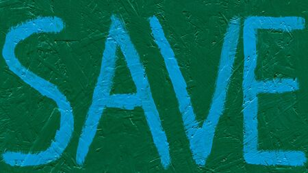 Blue lettering save on a green background. Font written with a brush on a wooden wall. Save the inscription of ecological meaning