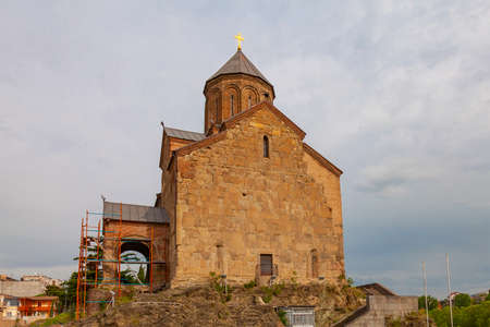 Old Orthodox Church Metekhi on the banks of the Kura River in the city of Tbilisi, Georgia. The 13th century Metekhi fortress and the monument of the Georgian king Vakhtang Gorgasal.