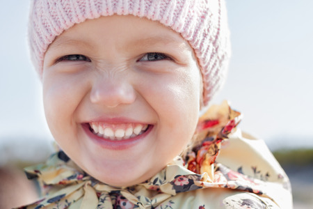child girl funny face happy smile closeup outdoor photo