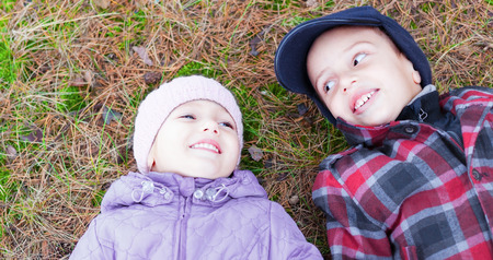 children happy smile brother sister lay ground photo