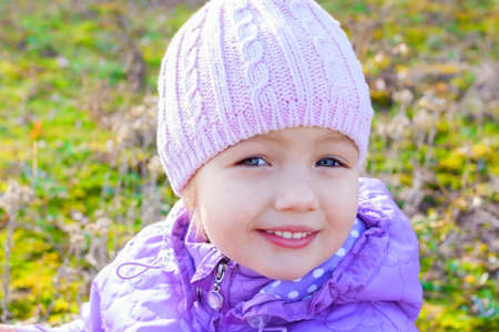 tiddler: little girl beautiful close up portrait outdoor Stock Photo