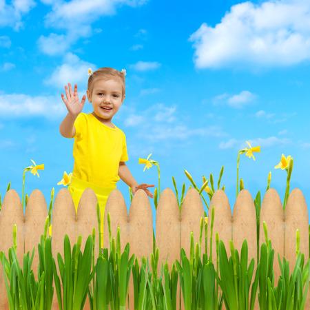 child girl happy flowers garden background waving hello hand up Standard-Bild