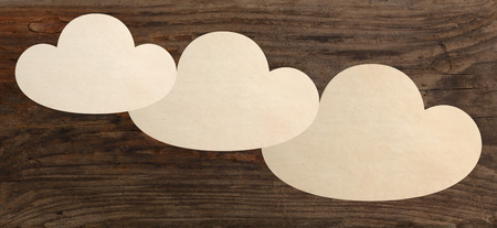 i t: paper pieces clouds shape wooden background template Stock Photo