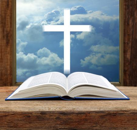 Bible christian cross stormy sky view window open wood
