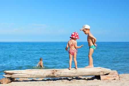 swimsuite: beach children play swimming costume summer vacations