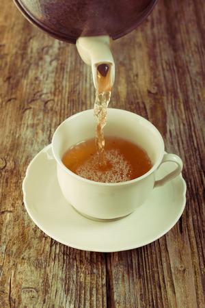 tea pour cup pot wooden table cafe   filter tint
