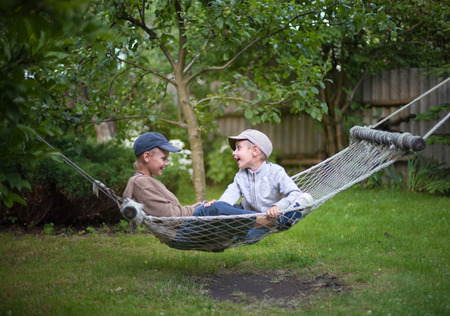 narrate: children brothers talking  country garden outdoor selective focus