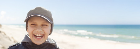 expressional: panoramic  child closeup happy smile portrait outdoor backlight