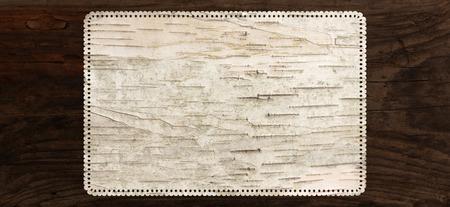 birch bark texture background perforated tag edge Standard-Bild
