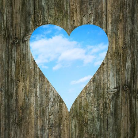heart shaped window wooden sky clouds view Standard-Bild