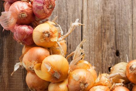 onions brunch wooden wall background Reklamní fotografie