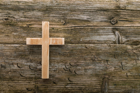 christianity: christian cross old wood on wooden  background christianity symbol