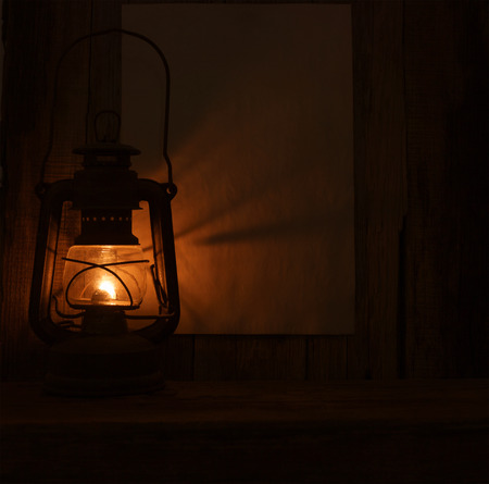 gas lamp old on wooden table barn wall background