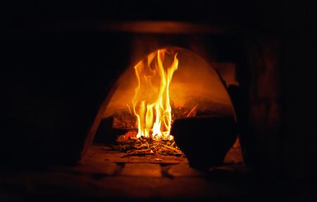 oven open flame burn old pot abstract background natural light selective focus stylized Reklamní fotografie