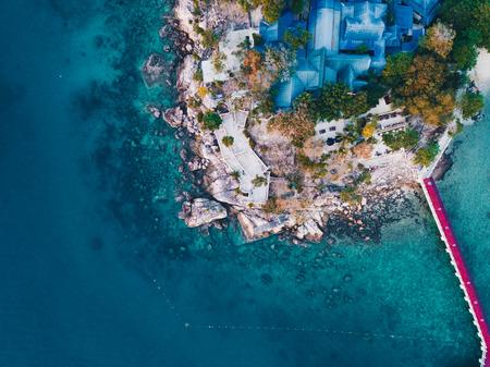 Aerial view of a resort and rocky beach at Perhentian Islands, Terengganu