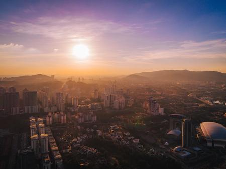 city park skyline: Sunset at Sri Hartamas, Kuala Lumpur, Malaysia from a drone