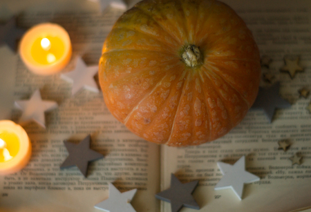 Happy Halloween with pumpkine, candle, books, stars and scrolls