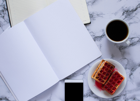 business lunch with coffee and waffles and planning the day on marble background