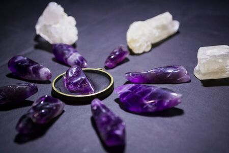 Top view on amethysts and quartz on dark background