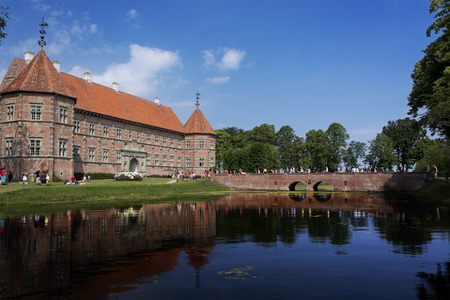 Medieval castle with lake and bridge in Denmark, near Aalborg. Stock Photo