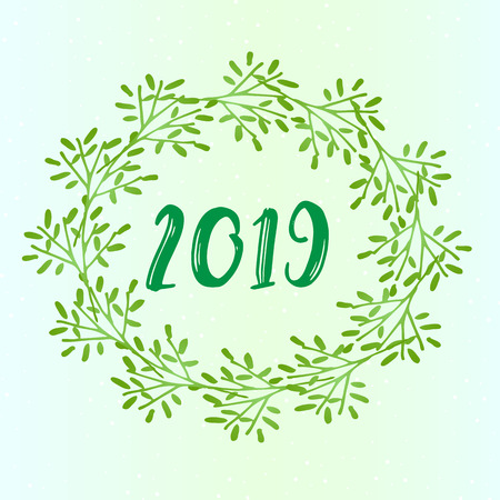 The new year 2019 is a beautiful idea for a greeting card. Green wreath close-up and snow pattern on a green gradient background.