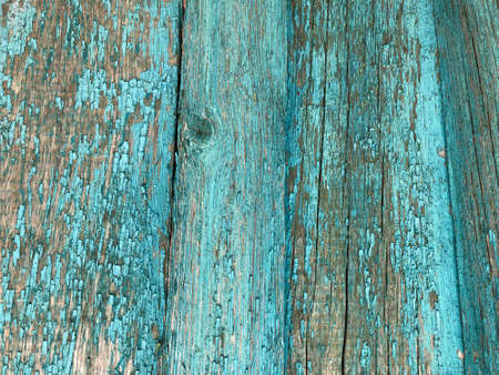 light blue wooden house wall with peeling old paint, texture. peeled blue paint on wood texture - vintage background