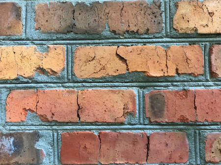 An old brick wall showing close up detail. Vintage brick wall close-up, background texture Zdjęcie Seryjne