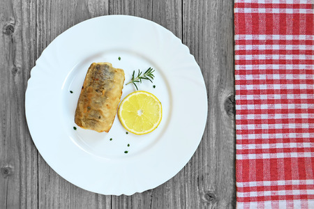 hake: A piece of fried hake fish on the plate