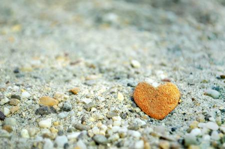 shaped: Heart shaped stone on the sand