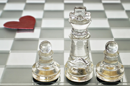 chess board: Happy Fathers Day: king, queen and pawns on chess board