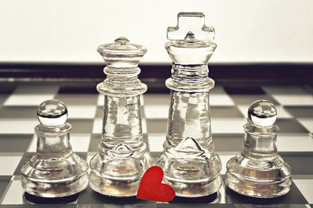 card board: Happy Fathers Day concept: king, queen and pawns on chess board Stock Photo