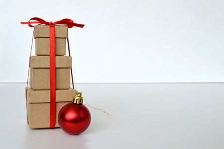 tied together: Three Christmas gift boxes tied together with red ribbon Stock Photo