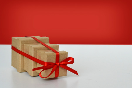 tied together: Three gift boxes tied together with red ribbon Stock Photo