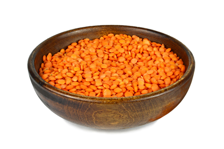 Red lentil beans in bowl isolated on white