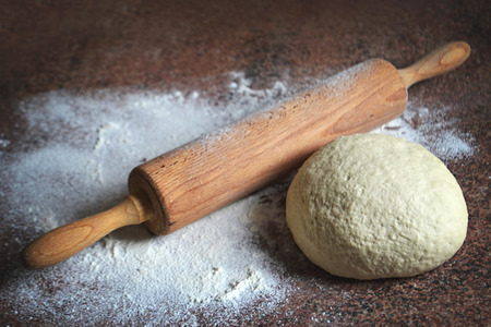 pin board: Homemade dough and rolling pin on kitchen board