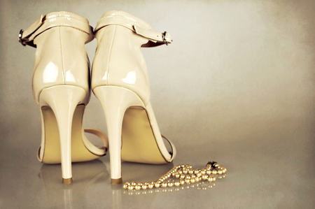 Wedding shoes on grunge background