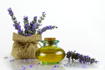 lavender oil: Lavender oil and lavender flowers