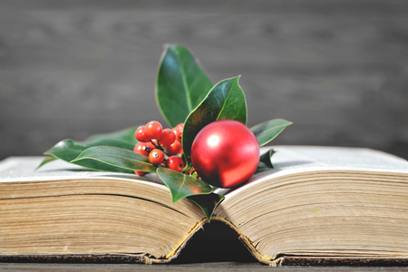 Christmas card with Christmas decoration and old book Stock Photo