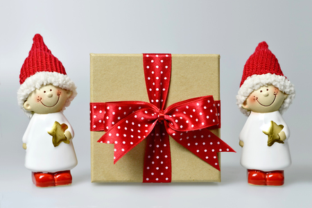 elves: Christmas gift and Christmas elves on light background
